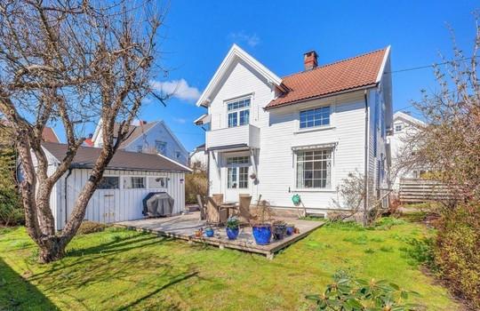Hvor mye ble nabohuset solgt for?